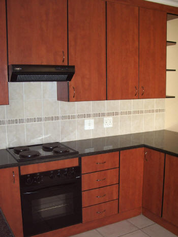 A Kitchen In Cherry Royale With Black Seen Edging And Rustenburg Granite Tops